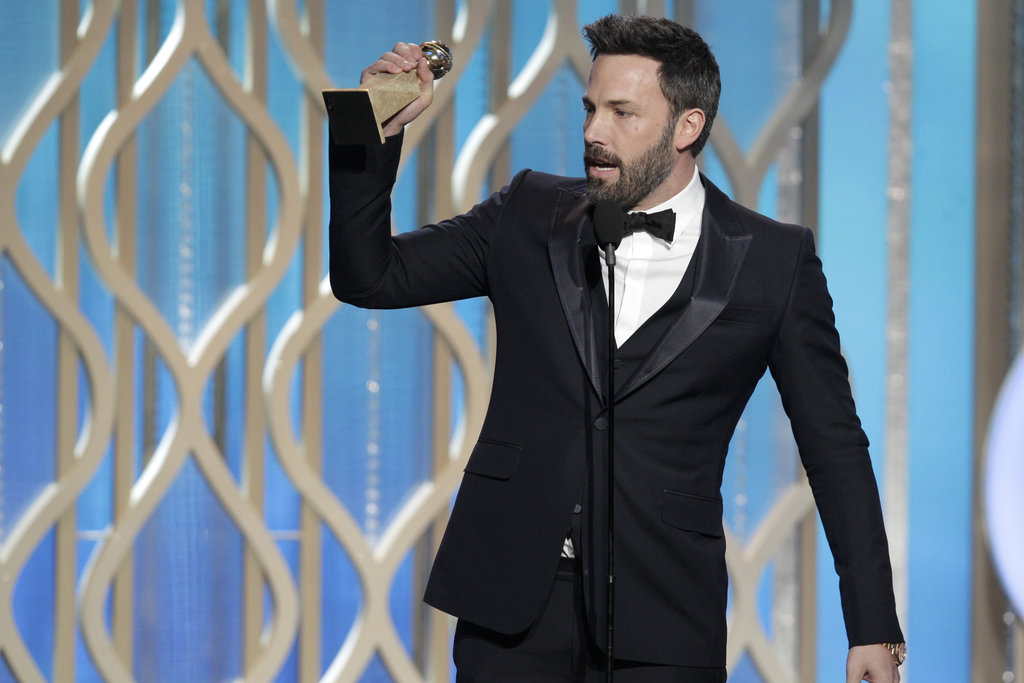 Ben Affleck got emotional while accepting his award and thanking his family during his speech.