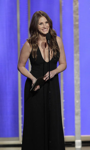 Julia Roberts presented at the Golden Globes in a black dress.