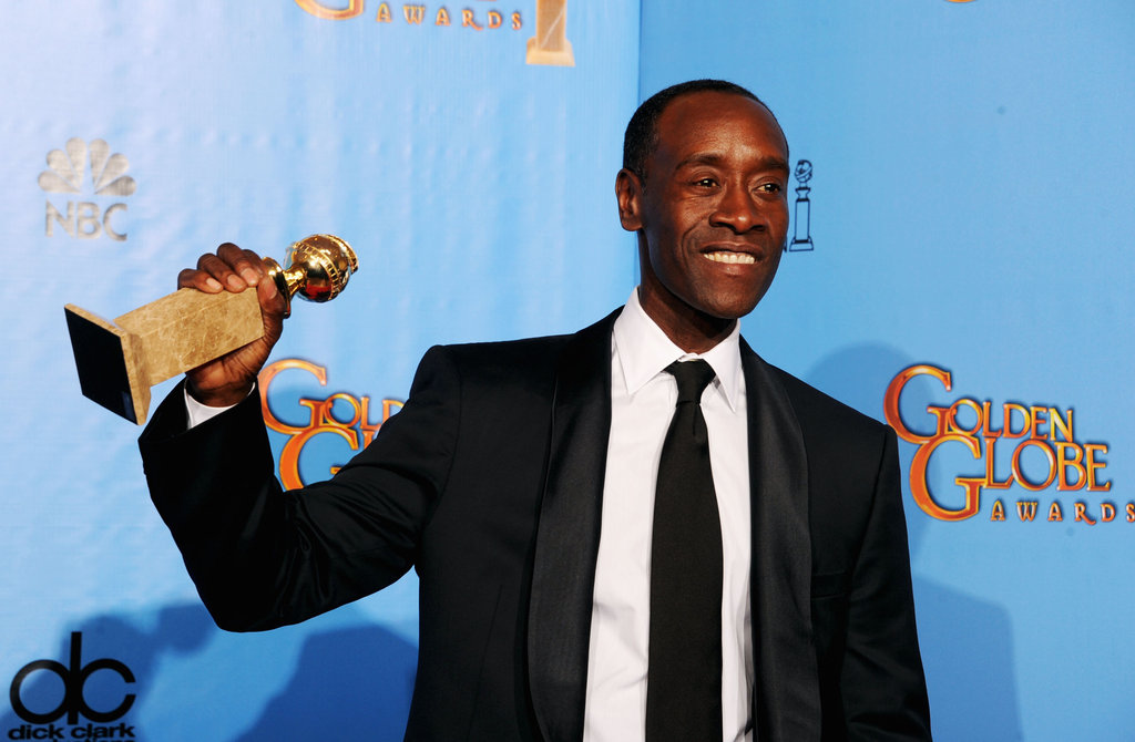 Don Cheadle showed off his statue for House of Lies in the press room.