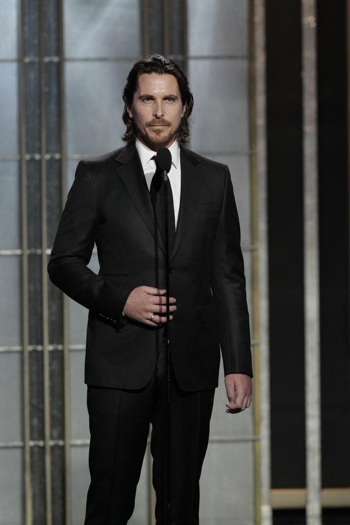 Christian Bale wore a classic black suit.