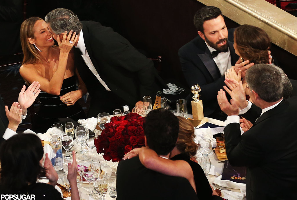 Stacy Keibler and George Clooney showed affection during the Golden Globes.