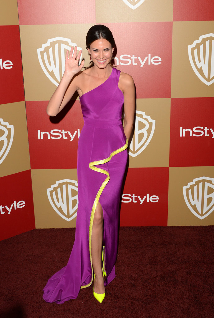 Odette Annable stepped up her colour game with this fuchsia one-shouldered gown, but the real kicker was the bright yellow lining on the thigh-high split.