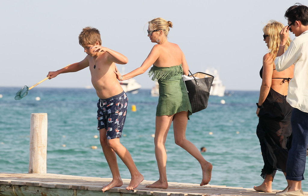 Kate Moss pushed a kid into the Mediterranean while in Saint-Tropez during August 2011.