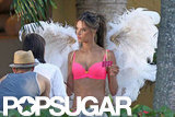 Alessandra Ambrosio wore a bright pink bra for her Victoria's Secret shoot in Miami.