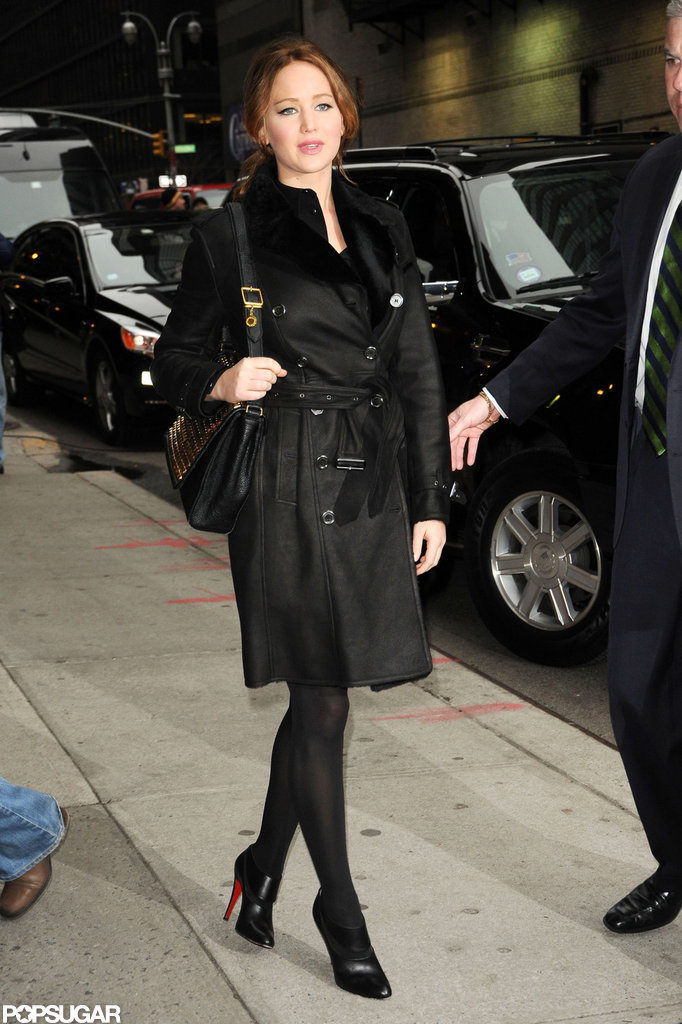 Jennifer Lawrence wore a black overcoat and black booties for a stop by Late Show with David Letterman.