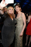 At the Critics' Choice Awards, Anne Hathaway posed for a photo with Rebel Wilson.