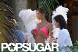 Alessandra Ambrosio wore angel wings and a bright pink bra for her Victoria's Secret shoot in Miami.