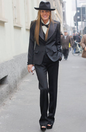 Anna Dello Russo showcased a little menswear flair in a full tuxedo, bow tie, and hat on the streets of Milan.