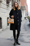 An adorable bag had a wow-factor influence on black outerwear.