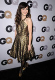 We love the double dose of gold via Zooey's halter-style dress and glitter Miu Miu pumps at the 2011 GQ Men of the Year party.