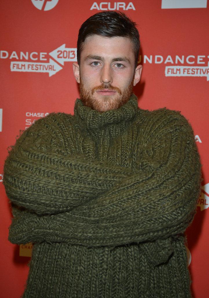 James Frecheville wore a green sweater.
