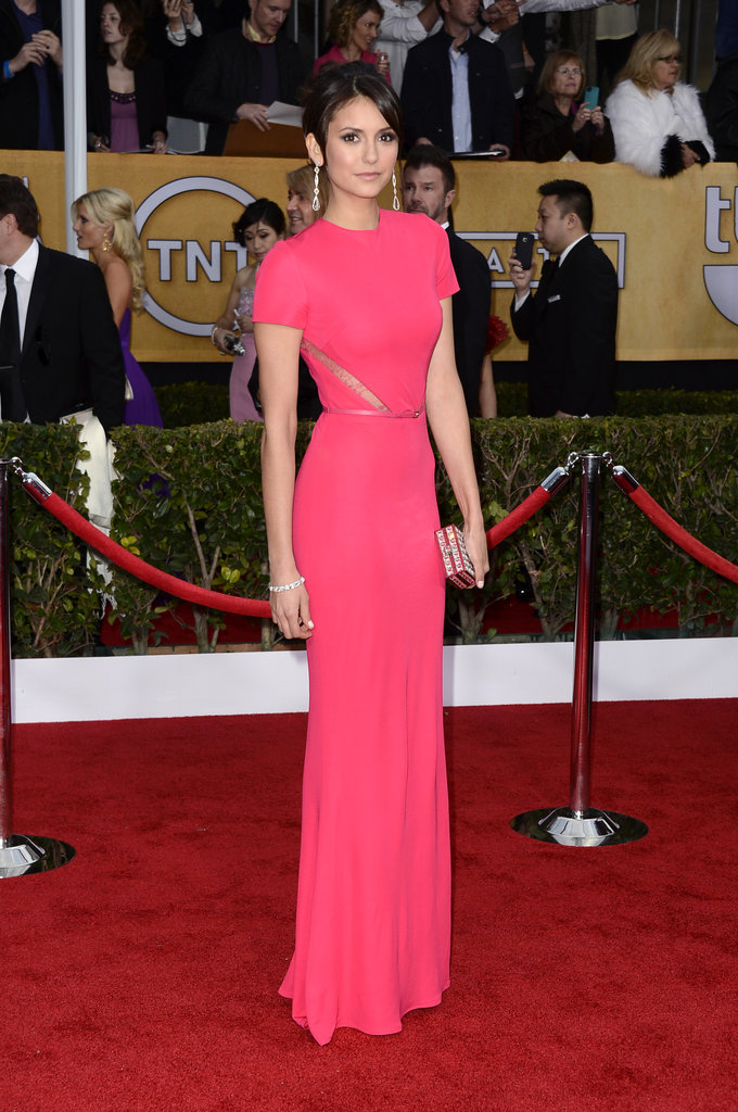 Nina Dobrev wore a pop of color on the red carpet.