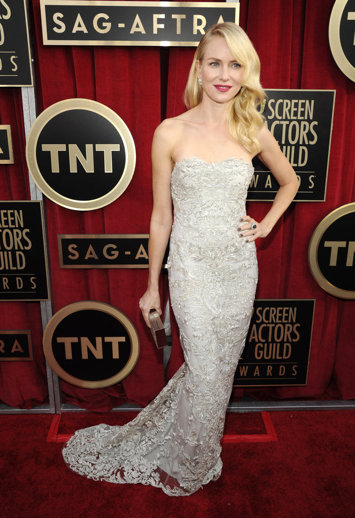 Naomi Watts struck a pose in a silver metallic embroidered Marchesa gown with gray satin Christian Louboutin pumps and dazzling Fabergé earrings.
