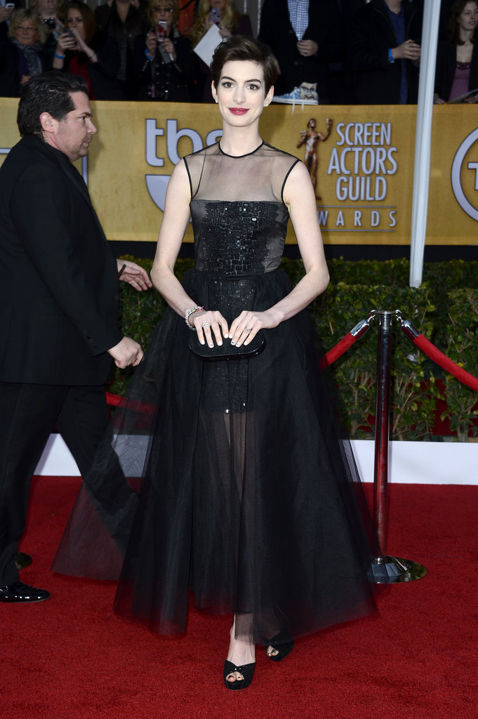 Anne Hathaway channeled retro glamour in a tea-length Giambattista Valli gown.