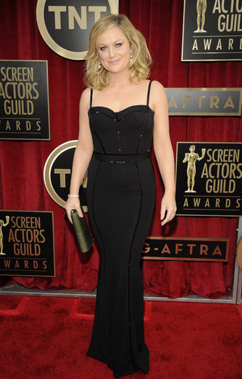 Amy Poehler flaunted her figure in a Zuhair Murad dress that also showed off a sweetheart neckline.