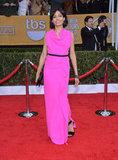 Freida Pinto was pretty in pink working an eye-catching Roland Mouret gown with black ankle-strap sandals, a matching clutch, and Lorraine Schwartz jewels.