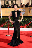 The Last Stand's Jaimie Alexander put the focus on her figure in this Marc Bouwer gown with a plunging neckline.