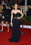 Tina Fey looked fabulous in a strapless corseted Oscar de la Renta gown cinched with a metallic belt.