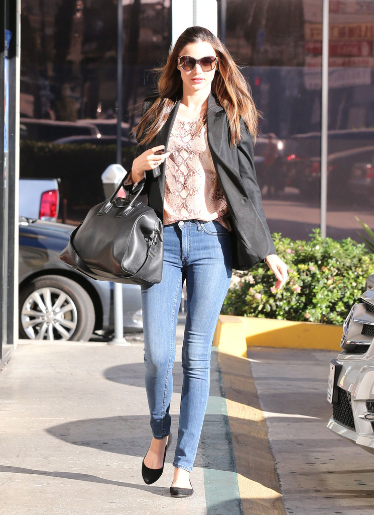 Miranda made a salon stop in another Equipment blouse (this time in a saucy snakeskin print) with skinny jeans and a black Givenchy tote.
