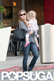 Amy Adams carried Aviana while shopping.