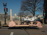 A replica of the Curiosity rover heads to the Inaugural Parade staging area. Source: Flickr User NASA HQ