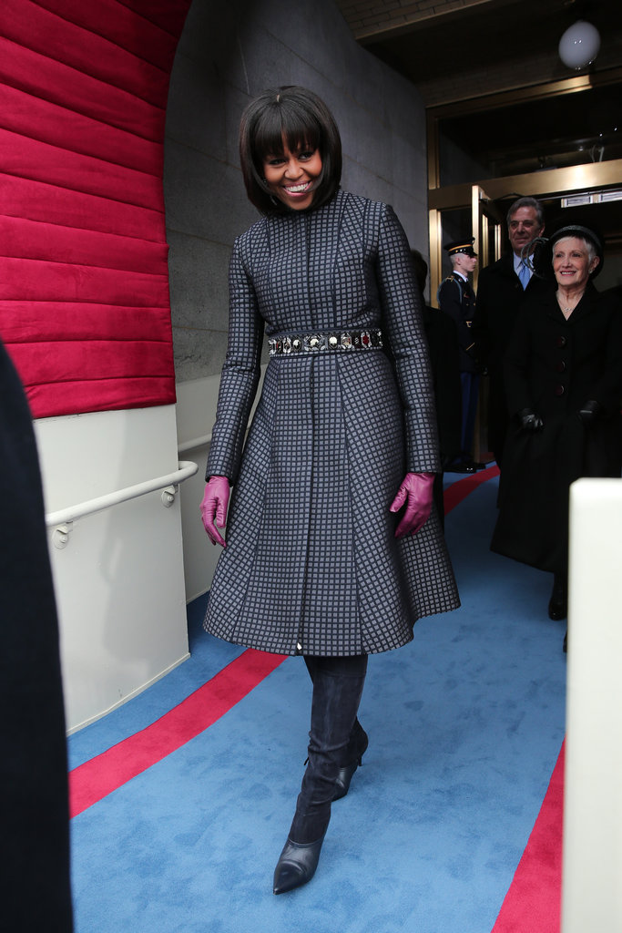 Michelle Obama was the picture of wintry perfection as she stepped out at the capitol. She kept the Thom Browne coat, belted it with a J.Crew embellished belt, added suede knee-high boots and berry-hued gloves, and made us fall in love with her all over again.