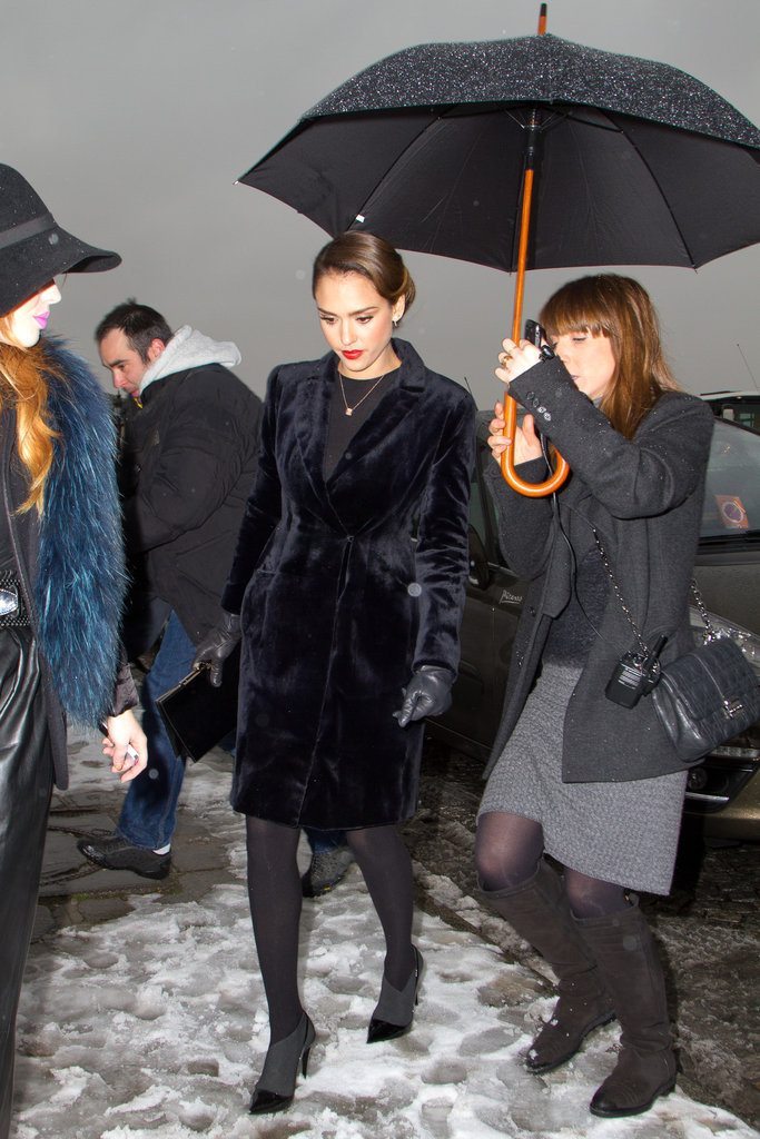 Jessica Alba braved the Parisian snow in a velvet coat, leather gloves, opaque tights, and two-tone ankle boots.