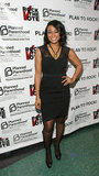 Tatyana Ali attended the Planned Parenthood and Rock the Vote inauguration party wearing a fitted black lace dress with a statement necklace and peep-toe pumps.