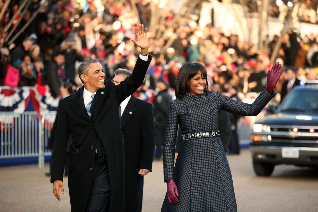 Barack and Michelle Obama waved to the crowds during their walk along the inaugural parade route.