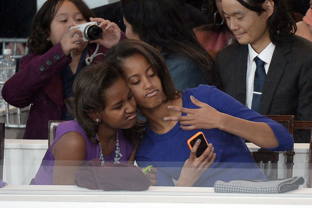Malia and Sasha Obama took a pic of themselves with an iPhone during the inaugural parade.