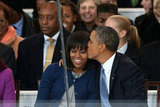 President Barack Obama gave wife Michelle a sweet kiss during the inaugural parade.