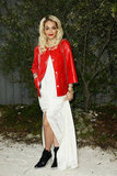 Rita Ora struck a colour contrast in bright red, crisp white, and stark black at the Chanel Couture Spring '13 show.
