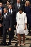 The day after the inaugural ball, Michelle Obama attended the national prayer service (the final inauguration event), at the Washington National Cathedral wearing a custom ivory wool-applique Naeem Khan coat and matching sleeveless dress.