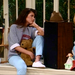 "We all loved ""casual hanging out at home"" Kelly — her off-the-shoulder Bayside Tigers sweatshirt, light-washed jeans, and white Keds make for a perfect '90s loungewear look.
