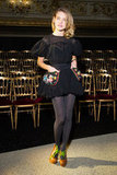 Natalia Vodianova made a voluminous LBD pop with semisheer gray tights and a bright pair of booties at the Ulyana Sergeenko show.
