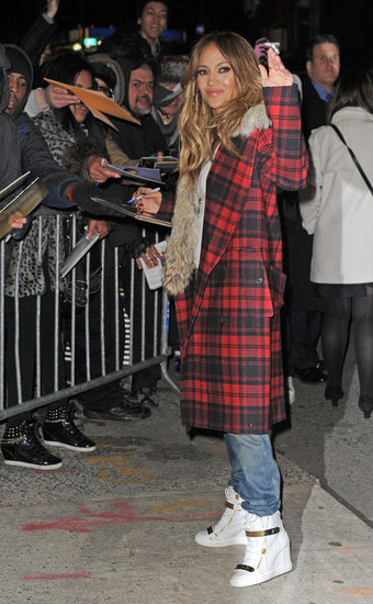 Jennifer Lopez changed into sneakers and a plaid coat in NYC.