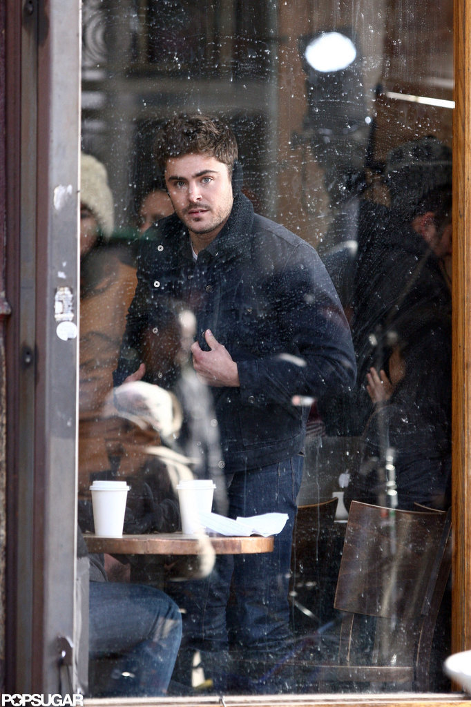 Zac Efron kept warm in some earmuffs to film for Are We Officially Dating? in NYC.