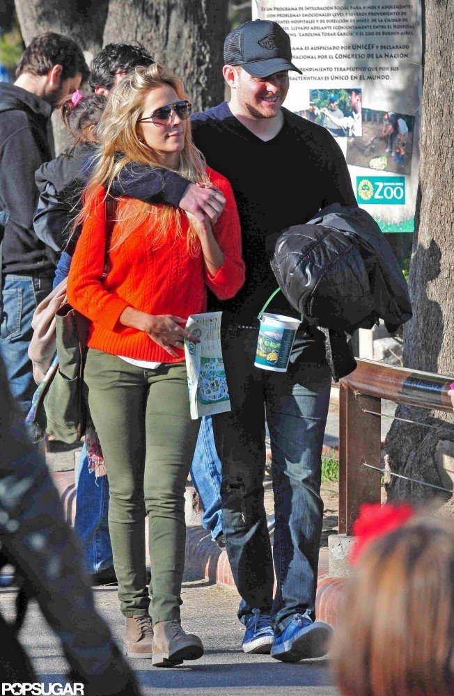 Michael Bublé had his arm around Luisana Lopilato as they toured the Buenos Aires Zoo in September 2011.