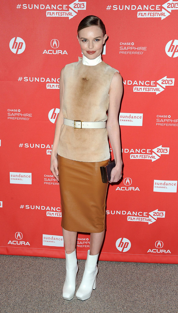 Kate Bosworth attended the premiere of Big Sur wearing a Calvin Klein look comprised of a sleeveless shearling top, vinyl pencil skirt, and white boots.