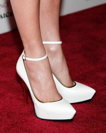 Lopez accessorized her all-white look with Lanvin ankle-strap pumps. White pumps might be hard to pull off in the Winter (mud, slush, snow), but come warmer weather, we suggest pairing such statement shoes with sleek pencil skirts and effortless Spring dresses.