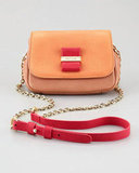 We adore the camel-and-red color combo on this See by Chloé Rosita minibag ($295).