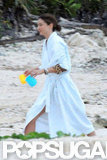 Miranda Kerr wore a white robe on the beach in Mexico.