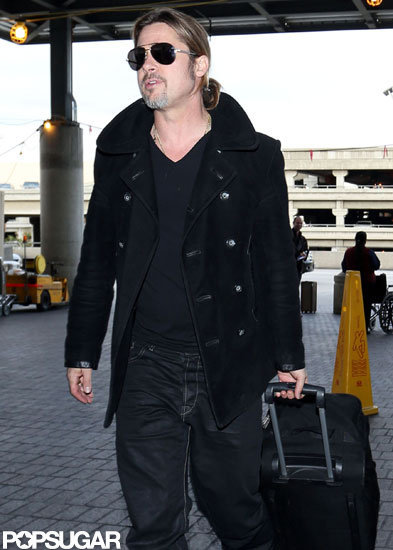 Brad Pitt wheeled his luggage into LAX.