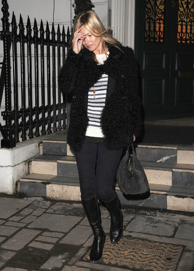 Kate Moss wore a furry jacket and striped sweater.