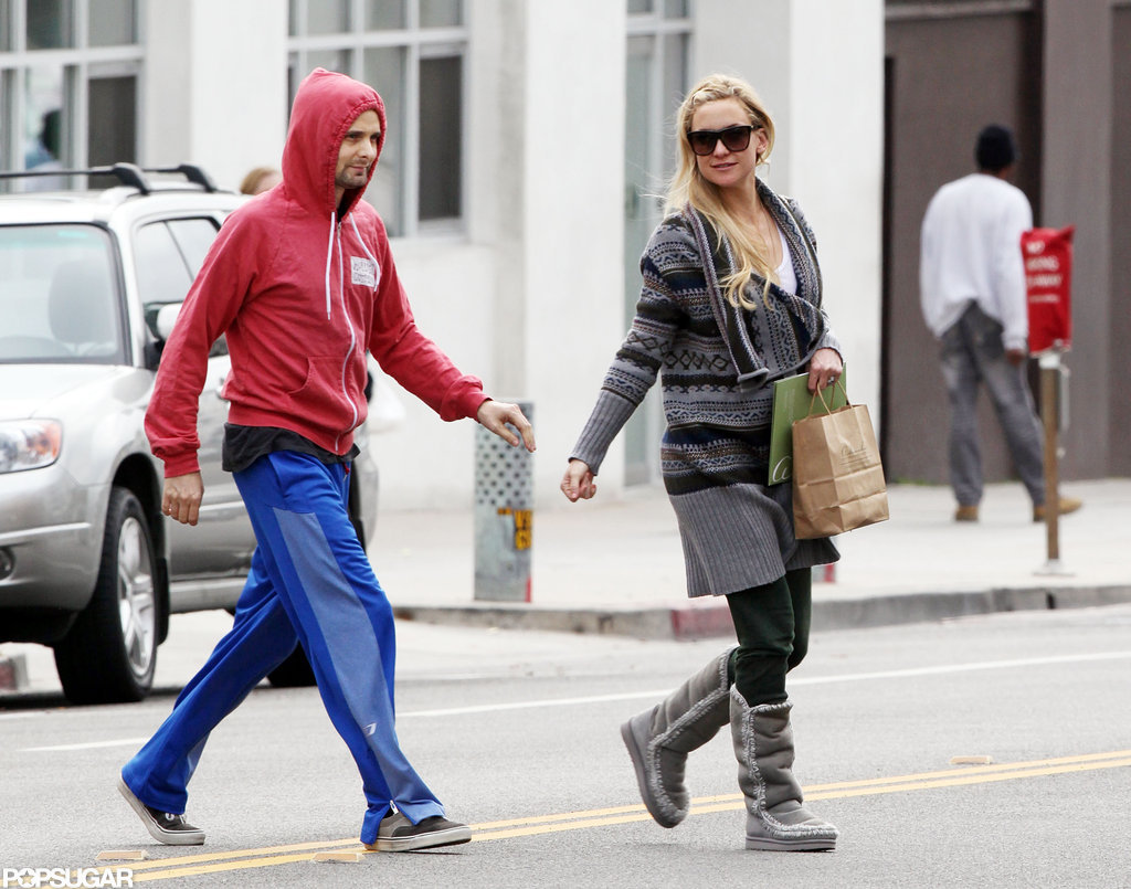 Kate Hudson wore a grey knit and sunglasses while out with fiance, Matthew Belamy, in Santa Monica.