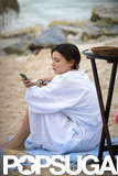 Miranda Kerr relaxed and checked her phone while on vacation.