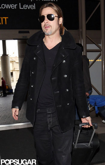 Brad Pitt had sunglasses on as he arrived at LAX.