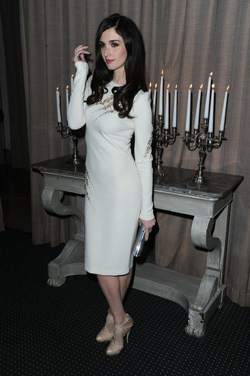 "Paz Vega chose a long-sleeved white cocktail sheath, along with a pair of nude heels, for the Sidaction Gala. The best part? The sexy embellished ""cutouts"" along the neckline, waist, and sleeves."