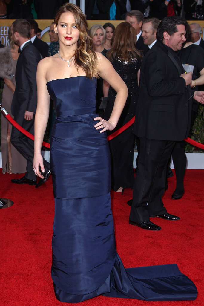 Jennifer Lawrence wore a Dior Haute Couture gown with bright lips to hit the SAG Awards red carpet.