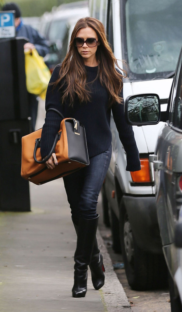 Victoria Beckham stepped out in boots and jeans in London.